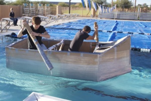 two students in cardboard boat
